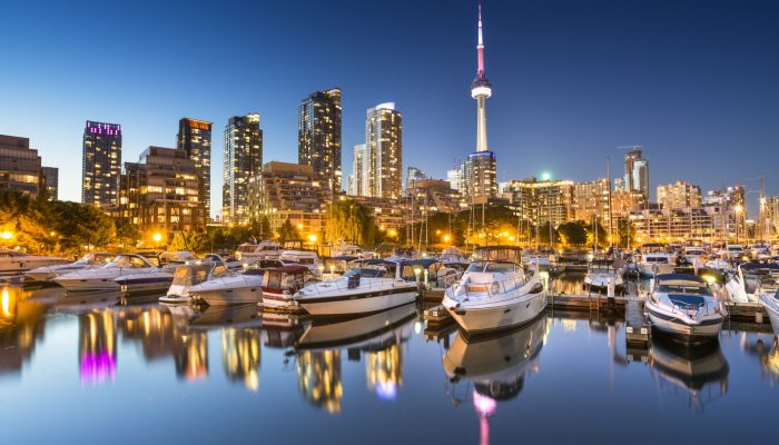 City skyline view of CN Tower in Toronto, Ontario, Canada from the marina along Lake Ontario